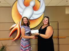 LuAnn Hansen presents a check to Diane McKee, Phoenix House in the amount of $1,250.00